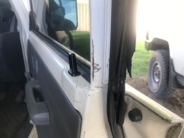 The torn seal and the worn paints is from people using a wire to break into the car. This is how often thieves try to steal things.